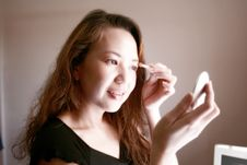 Free Woman Applying Make-up, Eye-shadow Stock Image - 781411