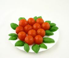 Small Fresh Tomatoes With Basil Stock Photography