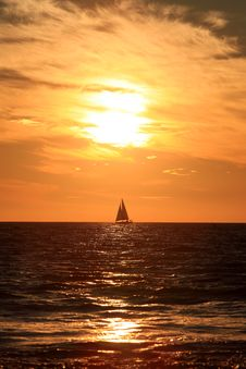 Sunset And Sailing Ship Stock Photography