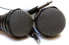 Two Black Wired Karaoke Microphones. Royalty Free Stock Photography