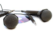 Two Black Wired Karaoke Microphones And CD. Stock Images