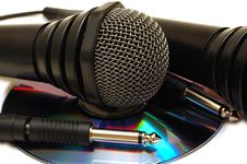 Two Black Wired Karaoke Microphones And CD. Stock Photos