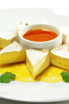 Fromage Cheese With Honey Orange Sauce Stock Photo