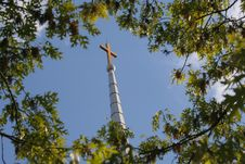 Free Cross On Steeple Framed By Trees Stock Images - 7800614
