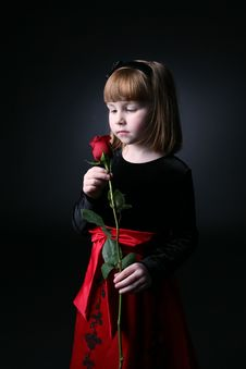 Free Young Girl Smelling A Long Stemmed Rose Royalty Free Stock Images - 7802779