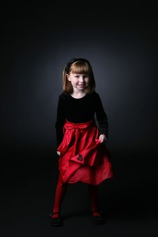 Free Pretty Young Girl In Red Dress Spinning Stock Photography - 7802822