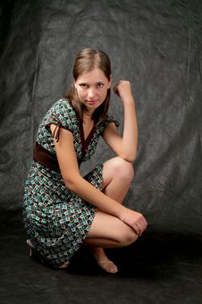 Free Girl In Color Dress Sitting On Black Stock Photography - 7812862