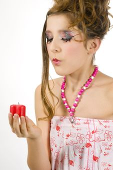 Free Girl Blowing Out A Red Candle Stock Photos - 7813953