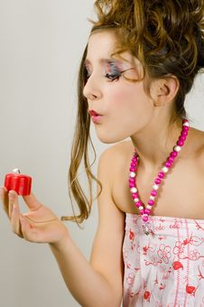 Free Girl Blowing Out A Red Candle Stock Images - 7813964