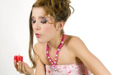 Free Girl Blowing Out A Red Candle Royalty Free Stock Images - 7813979