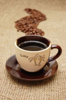 Coffee Cup And Beans In Shape Of Steam Stock Photo
