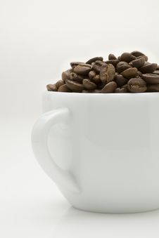 Free Coffee Bean In A Cup Royalty Free Stock Photo - 7817505