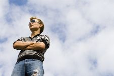 Young Beautiful Man Model Standing Under The Cloud