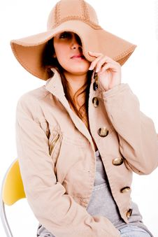 Side View Of Young Woman Holding Her Hat Stock Image