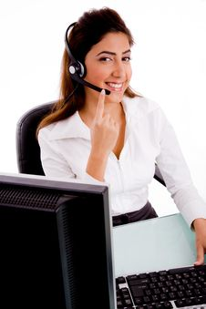 Side Pose Of Smiling Telecaller Stock Photo