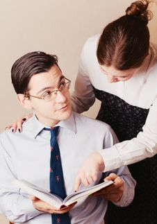 A Woman Showing Something Ot A Man Royalty Free Stock Photos