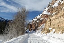 Mountain Road In Winter With Car Royalty Free Stock Image