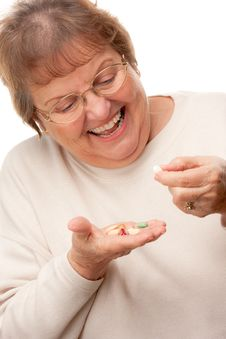 Free Attractive Senior Woman And Pills Royalty Free Stock Photo - 7826485