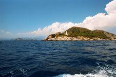 Lighthouse On Island Royalty Free Stock Image