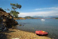 Anchored Yacht At Beautiful Coast Royalty Free Stock Photos