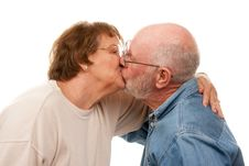 Free Affectionate Senior Couple Kissing Royalty Free Stock Image - 7826636