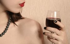 Lips And A Glass Of Wine. Royalty Free Stock Images