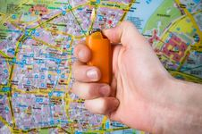 Free Hand With Lighter Over Map Stock Image - 7831581