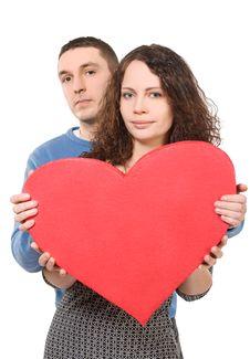 Loving Couple Holding Big Heart Stock Images