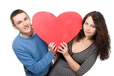 Happy Loving Couple With Red Heart Royalty Free Stock Images