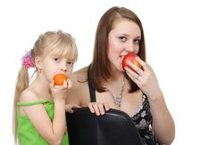 The Child And Girl With Fruit Stock Photo