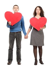 Free Couple Holding Two Red Hearts Stock Photo - 7834260