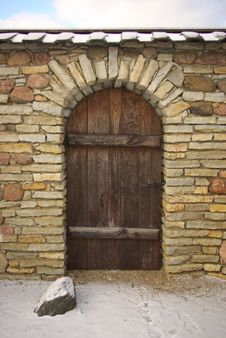 Wooden Door In Stone Wall Royalty Free Stock Photo