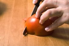 Hands Slicing Tomatoe. Stock Photo