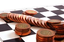 Columns Of Coins On The Chessboard Royalty Free Stock Photos