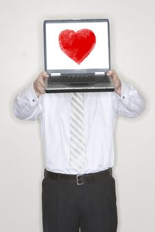Businessman Holding Laptop With Heart Stock Photo