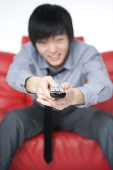 The Smiling Young Man In A Grey Shirt Watches TV Royalty Free Stock Photo