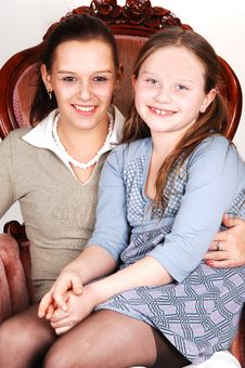 Mother And Daughter In Armchair. Stock Photography