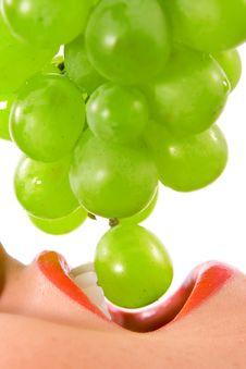 Beautiful Young Woman Eating An Grape Stock Photo