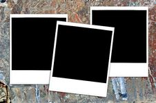 Instant Photos On Grungy Painted Surface Stock Photo