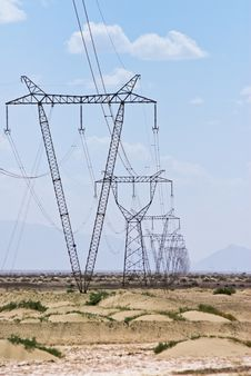 Array Of Electric Pylons  In Desert Stock Photo