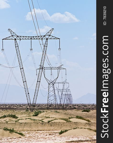 Array of electric pylons  in desert