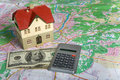Free Miniature House On Money Royalty Free Stock Photos - 7840628