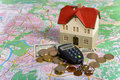 Free Miniature House On Money Royalty Free Stock Images - 7840729