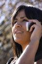 Free Hispanic Woman On Cell Phone Royalty Free Stock Image - 7847436