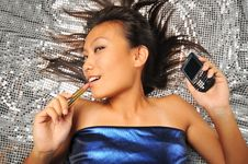 Free Asian Chinese Woman With Lipstick Swaying To Music Stock Images - 7840164
