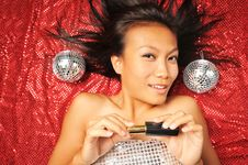 Asian Chinese Woman Preparing To Put On Make-up Stock Images