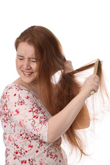 The Girl Who Combs Hair Royalty Free Stock Photography