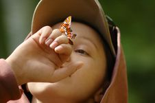 Free Picture Of A Happy Girl With A Butterfly Royalty Free Stock Photography - 7844557