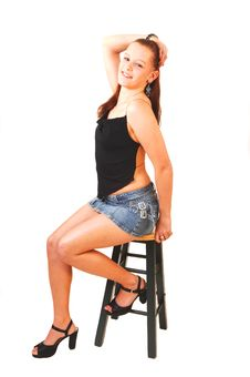 Free Beautiful Woman Sitting On A Bar Chair. Stock Images - 7848984