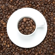 Background With White Cup And Coffee Beans Royalty Free Stock Images